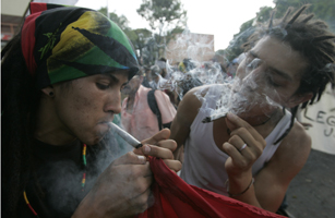 Protesters smoke marijuana during a demonstration against penalties for the consumption of small amounts of drugs, in Medellin
