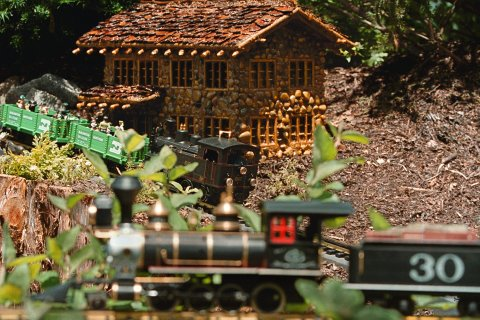 MODEL TRAINS IN A MODEL GARDEN EXHIBIT