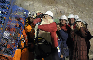 Chilean miner Florencio Avalos reaches the surface as the first of the 33 trapped miners to be hoisted to safety in Copiapo