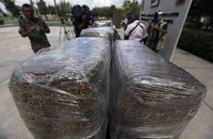 Packages of marijuana seized during an operation are displayed to the media at a military zone on the outskirts of Monterrey