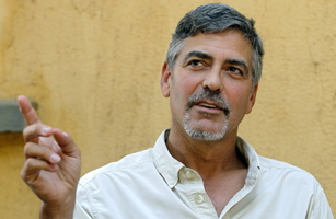 Actor Clooney gestures during an interview with Reuters in Southern Sudan's capital Juba
