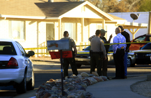 Law enforcement personnel stand outside home of Loughner, identified by federal officials as suspect responsible for the shooting of Giffords, in Tucson, Arizona