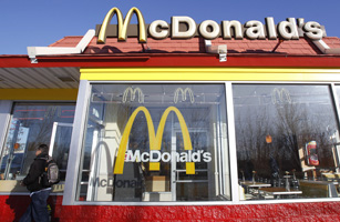 A man walks out of a McDonald's restaurant in New York
