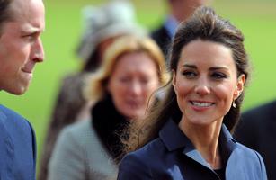 Kate Middleton, (R) looks towards her fi