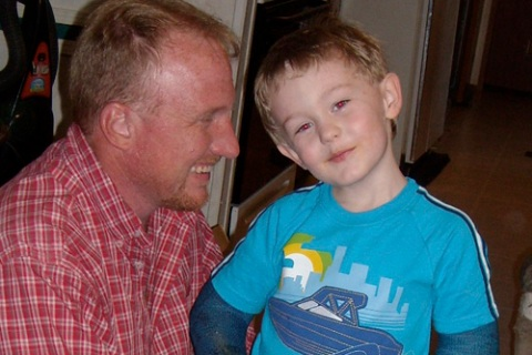 Five-year-old Garrett LeClere and his foster father Jeff McCormick are pictured in Phil Campbell
