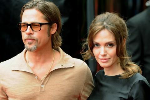 Actors Brad Pitt and Angelina Jolie arri