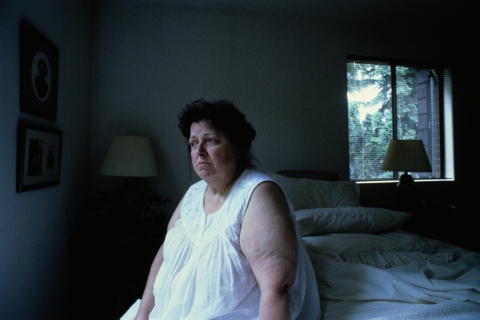Obese Woman in Bedroom