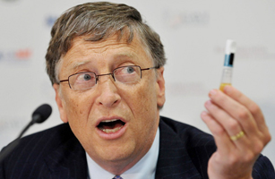 Microsoft tycoon Bill Gates holds a vial