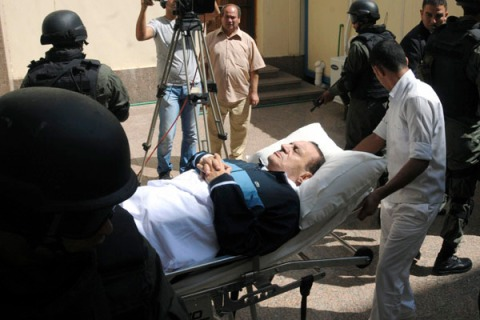File photo of members of the special forces standing guard while former Egyptian President Mubarak lies on bed at police academy in Cairo