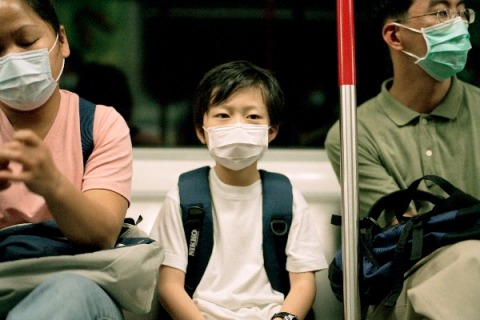 Masked passengers on subway during SARS outbreak 2003
