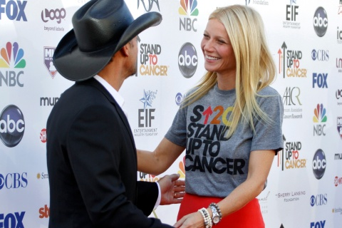 Country musician Tim McGraw greets actress Gwyneth Paltrow as they arrive for the Stand Up To Cancer telethon in Los Angeles, California