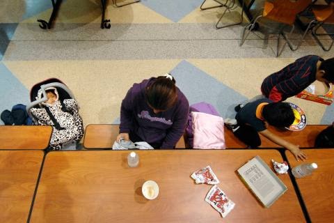 Cristina Morales and her children, including 8-months old baby Angie, take shelter from approaching Hurricane Sandy at a Red Cross shelter at Cape Henlopen High School in Lewes, Dela., Oct. 29, 2012