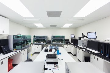 image: One of the sample processing rooms in the CLIA-certified laboratory; DNA samples are applied to 23andMe's custom genotyping array and analyzed here.