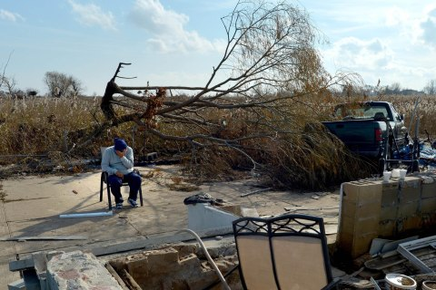 image: Kulib Abbas sits in a chair near the remains of his home as people in the area continue to deal with the aftermath of Hurricane Sandy in the Oakwood Beach neighborhood of Staten Island, New York, Nov. 12, 2012.