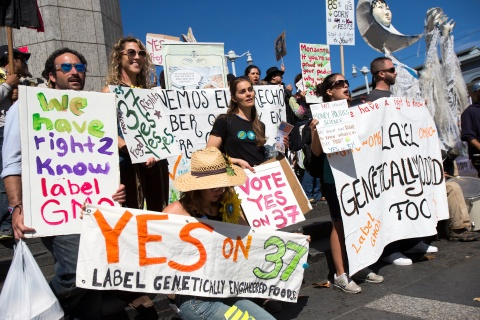 A group of demonstrators hold signs during a rally in support of the state's upcoming Proposition 37 ballot measure in San Francisco