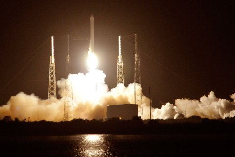image: SpaceX's Falcon 9 rocket blasts off as it heads for space carrying the company's Dragon CRX-1 spacecraft at Cape Canaveral, Fla., Oct. 7, 2012.