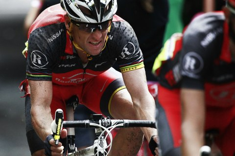image: Lance Armstrong rides after crashing in the second stage of the 2010 Tour de France cycling race, July 5, 2010.