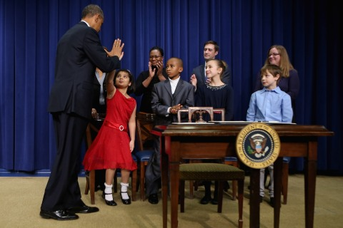 President Barack Obama gives high-fives to children who wrote letters to the White House about gun violence