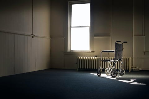 Wheelchair Sitting in Empty Room By Window