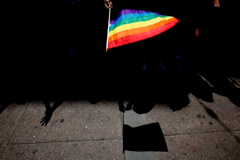 A parade goer waves a flag during 43rd annual San Francisco Lesbian, Gay, Bisexual, Transgender (LGBT) Pride Celebration & Parade, on June 30, 2013.