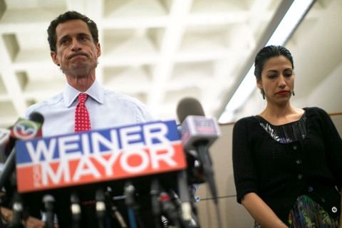 From left: New York mayoral candidate Anthony Weiner and his wife Huma Abedin attend a news conference in New York, July 23, 2013.