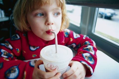 Child drinking soda