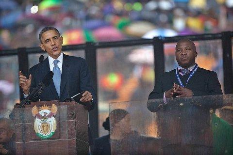 From left: U.S. President Barack Obama and Thamsanqa Jantjie during Obama's speech at the Nelson Mandela Memorial at FBN Stadium, Johannesburg, on Dec. 10, 2013.