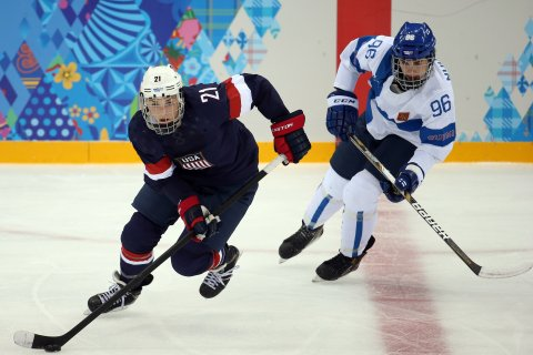 From left: U.S. forward Hilary Knight (21) skates ahead of Finland's Emma Nuutinen (96) during the second period in a women's hockey game at the 2014 Winter Olympics in Sochi, on Feb. 8, 2014.